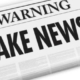 "Vector image of newspapers that have big headlines saying: ""Warning FAKE NEWS!"""