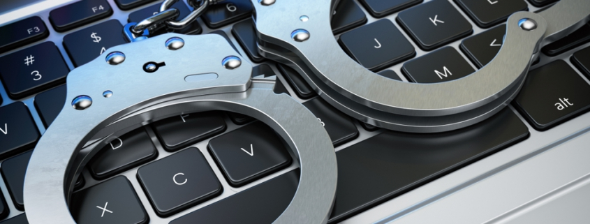 Image of cuffs in the laptop keyboard.